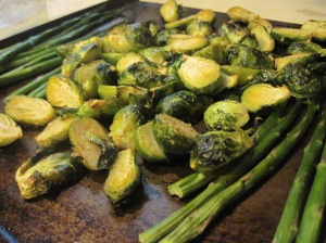Oven baked brussels sprouts with minced garlic and olive oil and some spears of asparagus.