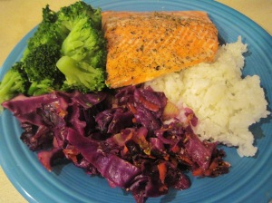 Tonight's meal is baked salmon with steamed broccoli and sautéed red cabbage.